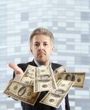 Businessman throwing dollar Royalty Free Stock Images