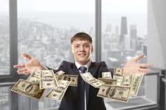 Businessman throwing dollar Stock Photos