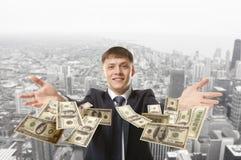 Businessman throwing dollar Royalty Free Stock Image