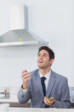 Businessman throwing grape in the air Royalty Free Stock Image