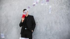 Man in suit throwing money. Successful business or winning the lottery. cash cannon money gun. Slow motion. Businessman throwing money from cash cannon money gun stock video
