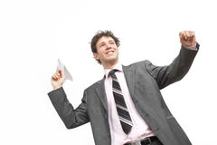 Businessman throwing paper airplane Stock Images