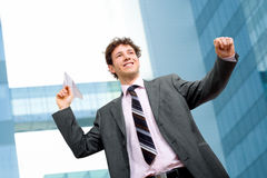 Businessman throwing paper airplane Stock Photography