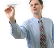 Businessman throwing a paper airplane stock image