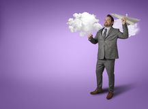 Businessman throwing paper plane with cloud Stock Images