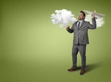 Businessman throwing paper plane with cloud Stock Photos