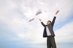 Businessman throwing papers Royalty Free Stock Photography