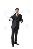 Businessman throwing papers Stock Photography