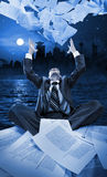 Businessman throwing papers at night royalty free stock photos