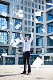 Businessman throwing paperwork Stock Image