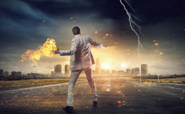 Businessman throwing petrol bomb . Mixed media Royalty Free Stock Photos