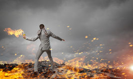 Businessman throwing petrol bomb . Mixed media Royalty Free Stock Image