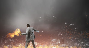 Businessman throwing petrol bomb . Mixed media Stock Image