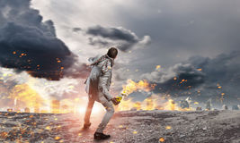 Businessman throwing petrol bomb . Mixed media Stock Images