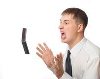 Businessman throwing phone. Isolated on white background stock image