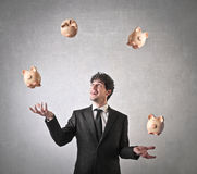 Businessman throwing piggy banks Royalty Free Stock Photography