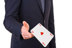 Businessman throwing playing cards. Royalty Free Stock Photos