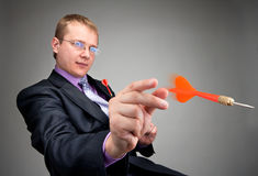 Businessman throwing red dart Royalty Free Stock Image