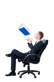 Businessman throwing up folder with documents Royalty Free Stock Photography