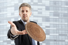 Businessman throws a coin Royalty Free Stock Photos