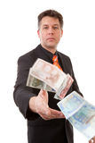 Businessman throws euro money Royalty Free Stock Photo