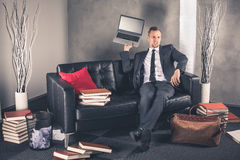 Businessman throws laptop Royalty Free Stock Photography