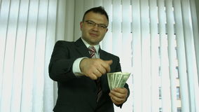 Businessman throws the money to camera. stock video footage