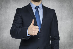 Businessman with thumb lifted upwards Stock Photos