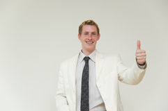Businessman with thumb up on. Young businessman with thumb up on Stock Image