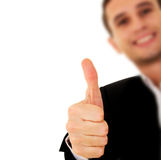 Businessman With Thumb Up. Young businessman shows his hand with thumb up royalty free stock photos