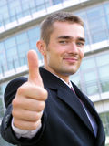 Businessman With Thumb Up. Standing Outside a Modern Office Building Royalty Free Stock Photos
