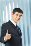 Businessman with thumb up. At office Stock Photography