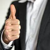 Businessman with thumb up. Body of businessman in suit with thumb up Stock Image
