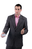 Businessman with thumb up holding business card Stock Photos