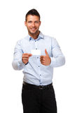 Businessman with thumb up and holding a card Royalty Free Stock Photos