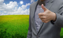 Businessman thumb up with nice green landscape background Royalty Free Stock Photo