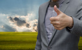 Businessman thumb up with nice landscape background Stock Photos