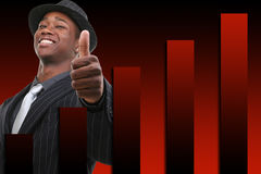 Businessman With Thumb Up Over Rising Graph Background. Red and black background Stock Photos