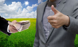 Businessman thumb up with profit from sustainable Stock Photos
