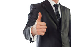 Businessman with thumb up. A businessman with thumb up. Shallow depth of field - focus on fingers Royalty Free Stock Photos