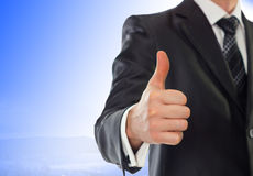 Businessman with thumb up. A businessman with thumb up. Shallow depth of field - focus on fingers Stock Image