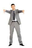 Businessman with thumbs down Royalty Free Stock Images