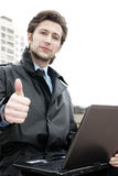 A businessman with thumbs up. Outdoors working businessman white and black photo Royalty Free Stock Image