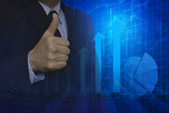 Businessman with thumbs up and arrow head,  Royalty Free Stock Photography