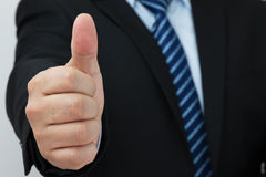 Businessman thumbs up Royalty Free Stock Photo