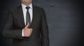 Businessman with thumbs up and copyspace