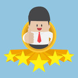Businessman thumbs up with five star rating Royalty Free Stock Photos