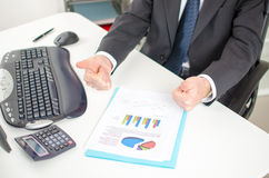Businessman with thumbs up before graphs Royalty Free Stock Photo