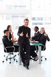 Businessman with thumbs up in a meeting Stock Photo