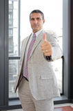 Businessman with thumbs up in outdoor Royalty Free Stock Photo